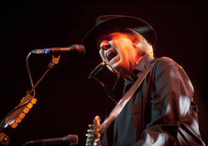 "Photo -   FILE - In this May 14, 2012 file photo originally provided by Robin Hood, musician Neil Young performs onstage at the Robin Hood Annual Benefit, Monday, May 14, 2012, at the Javits Center in New York. Young, whose memoir ""Waging Heavy Peace"" due out in October, will be interviewed by fellow singer Patti Smith at BookExpo America in New York this week. (AP Photo/Courtesy Robin Hood, file)"