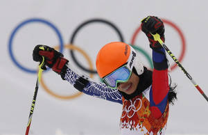 Photo - Violinst Vanessa Mae starting under her father name as Vanessa Vanakorn for Thailand celebrates after completing the first run of the women's giant slalom at the Sochi 2014 Winter Olympics, Tuesday, Feb. 18, 2014, in Krasnaya Polyana, Russia.(AP Photo/Christophe Ena)