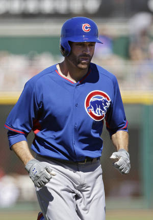 Photo - Chicago Cubs' Nate Schierholtz trots home after his two-run home run off Cincinnati Reds starting pitcher Alfredo Simon in the first inning of a spring training exhibition baseball game Saturday, March 8, 2014, in Goodyear, Ariz. (AP Photo/Mark Duncan)