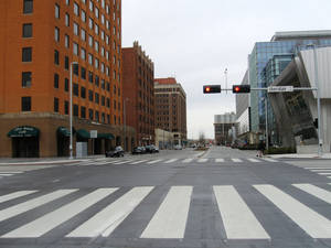 photo - Hudson Avenue is now a two-way street with wide pedestrian crosswalks and traffic limited to two lanes in each direction. <strong>Steve Lackmeyer</strong>