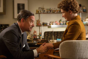 "Photo - This image released by Disney shows Tom Hanks as Walt Disney, left, and Emma Thompson as author P.L. Travers in a scene from ""Saving Mr. Banks."" (AP Photo/Disney, FranÁois Duhamel)"