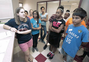 Photo - New teacher Katie Alsup talks to sixth-graders who will attend Belle Isle Enterprise Middle School this year. The first day of class for Oklahoma City Public Schools is Monday. <strong>PAUL HELLSTERN - THE OKLAHOMAN</strong>