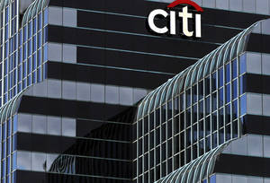 Photo -  This 2012 file photo shows a Citi Bank sign in Chicago. Citigroup will pay $7 billion to settle an investigation into risky subprime mortgages, the type that helped fuel the financial crisis. The agreement announced Monday comes weeks after talks between the sides broke down, prompting the government to warn that it would sue the New York investment bank. The settlement stems from the sale of securities made up of subprime mortgages, which fueled both the housing boom and bust that triggered the Great Recession at the end of 2007. AP Photo  <strong>Kiichiro Sato</strong>