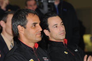 Photo - Juan Pablo Montoya, left, sits with Penske Racing teammate Helio Castroneves at the Indianapolis Motor Speedway Hall Of Fame Museum on Tuesday, Jan. 14, 2104, in Indianapolis. Montoya, who spent the last seven seasons in NASCAR, is driving in IndyCar this season. (AP Photo/The Indianapolis Star, Greg Griffo) NO SALES