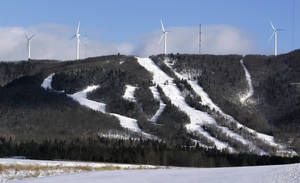 photo -   FILE - In this file photo made Jan. 17, 2007, wind turbines stand atop Mars Hills Mountain in Mars Hill, Maine. FirstWind and other wind power companies in Maine are working with snowmobilers' groups to make their sites destinations for winter sledders via 600 miles of trails that are mostly there already. (AP Photo/Robert F. Bukaty, File)