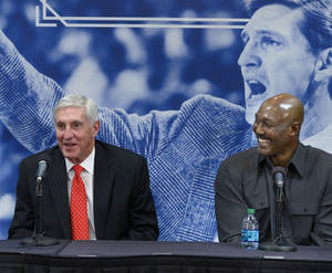 Photo - Karl Malone, right, laughs as former Utah Jazz coach Jerry Sloan speaks during a news conference to honor Sloan on Friday, Jan. 31, 2014, in Salt Lake City.  (AP Photo/The Salt Lake Tribune, Scott Sommerdorf) LOCAL TV OUT; MAGAZINES OUT; DESERET NEWS OUT