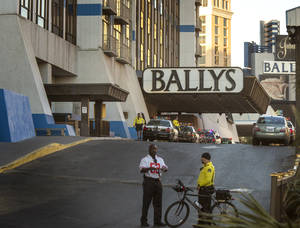 Photo - Security personnel watch the Flamingo Road entrance to Bally's Hotel-Casino on the Las Vegas Strip on Monday, Oct. 21, 2013. Las Vegas police said a man opened fire about 5:45 a.m. in the casino at 3645 Las Vegas Boulevard South, near Flamingo Road, after he was refused entrance to Drai's After Hours nightclub. The shooting left one dead and two others injured. (AP Photo/Las Vegas Review-Journal, Jeff Scheid)
