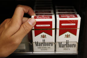 Photo - FILE - This Oct. 15, 2010 photo, Marlboro cigarettes are on display at a liquor store in Palo Alto, Calif. Marlboro maker Altria Group Inc. reports quarterly financial results before the market opens on Tuesday, July 22, 2014. (AP Photo/Paul Sakuma, File)