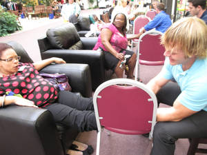 """Photo - Nicole Moore gets a foot massage from United Methodist Church of the Servant volunteer Derek Babb during the Single Parent Support Network's recent """"Queen For A Day"""" event at the church, 14343 N MacArthur.Photo by Carla Hinton, The Oklahoman <strong></strong>"""