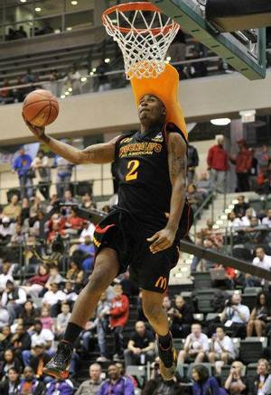 Photo - Oklahoma State signee LeBryan Nash competes in the slam dunk contest at the McDonald's High School All American basketball Jam Fest at Chicago State University in Chicago, Monday, March 28, 2011. Nash won the event. (AP Photo/Brian Kersey)