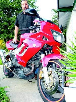 Photo - Paul Howell and his Honda Superhawk 996. (Muskogee Phoenix photo)