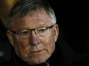 photo - Manchester United's manager Alex Ferguson looks on ahead of the English Premier League soccer match between Fulham and Manchester United at Craven Cottage stadium in London, Saturday, Feb. 2, 2013. (AP Photo/Kirsty Wigglesworth)