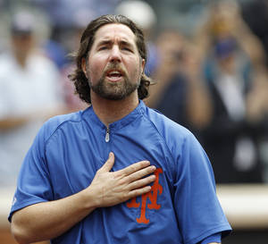 photo - FILE - This Sept. 27, 2012 file photo shows New York Mets starting pitcher R.A. Dickey reacting to fans as he celebrates his 20th victory of the season after the Mets 6-5 win against the Pittsburgh Pirates in a baseball game at Citi Field in New York. A person familiar with the deal tells The Associated Press that Dickey and the Blue Jays have agreed on a new contract, clearing the way for the New York Mets to trade the Cy Young winner to Toronto. The person spoke on condition of anonymity Monday, Dec. 17, 2012,  because the trade was not yet complete. The 38-year-old knuckleballer must pass a physical before he joins the Blue Jays. The Mets would get prized catching prospect Travis d&#039;Arnaud as the centerpiece of the multiplayer swap. (AP Photo/Kathy Willens, File)