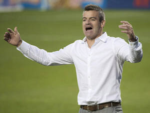 Photo - FILE - In this July 26, 2014, file photo, Toronto FC head coach Ryan Nelsen argues a call with one of the officials while playing against Sporting Kansas City during the second half of an MLS soccer game in Toronto. Toronto FC has fired Nelsen and his entire coaching staff in the wake of Nelsen's public dressing down of general manager Tim Bezbatchenko. (AP Photo/The Canadian Press, Nathan Denette, File)