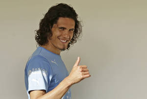 Photo - Uruguay's Edinson Cavani gestures to supporters at his team's hotel in Natal, Brazil, Wednesday, June 25, 2014. Uruguay will face Colombia in round 16 at the World Cup. (AP Photo/Petr David Josek)
