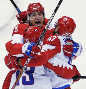Photo - Russia forward Alexander Ovechkin reacts with forward Pavel Datsyuk after Datsyuk scored a third period goal against the USA during a men's ice hockey game at the 2014 Winter Olympics, Saturday, Feb. 15, 2014, in Sochi, Russia. (AP Photo/Petr David Josek)