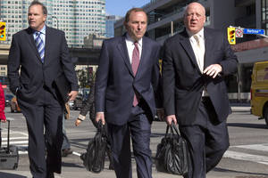 Photo -   NHL commissioner Gary Bettman, center, arrives with deputy commissioner Bill Daly, right, as the NHL and its locked-out player resume negotiations in Toronto on Wednesday Oct. 16, 2012. (AP Photo/The Canadian Press, Chris Young)
