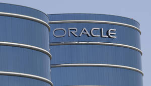 Photo -   FILE-This Monday, June 18, 2012, file photo shows the Oracle headquarters in Redwood City, Calif. Oracle's earnings matched analyst estimates in the latest quarter, but a revenue decline signaled the business software maker is having a tougher time closing deals. The fiscal first-quarter results announced Thursday, Sept. 20, 2012, are the latest indication that companies and government agencies are clamping down on technology spending amid mounting uncertainty about the economy. (AP Photo/Paul Sakuma, File)