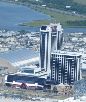 Photo - Trump Plaza Hotel and Casino in Atlantic City N.J., shown here on July 11, 2014, will shut down on Sept. 16, its parent company told The Associated Press on Saturday July 12, 2014. It would be the third Atlantic City casino to shut down this year, and more than 1,000 workers would lose their jobs. (AP Photo/Wayne Parry)