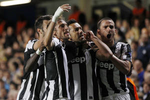 Photo -   Juventus' Fabio Quagliarella, second right, celebrates his goal against Chelsea with teammates during their Champions League group E soccer match at Stamford Bridge, London, Wednesday, Sept. 19, 2012. (AP Photo/Lefteris Pitarakis)