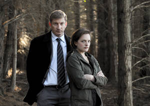 "Photo - This undated publicity image released by Sundance Channel shows David Wenham, left, and Elisabeth Moss in the Sundance Channel original miniseries ""Top of the Lake"". A TV miniseries and movie comeback will mean more Emmy Awards than expected at this year's ceremony. The TV academy's board of governors said it's reversing its 2012 decision to combine lead and supporting acting honors for such projects. In a statement, the board said that because of the ""unanticipated resurgence"" of TV miniseries and movies, it was reinstating the separate acting categories. The board was swayed by a rich field of potential contenders, including Elisabeth Moss and Holly Hunter in Sundance Channel's ""Top of the Lake"" and Ben Whishaw and Dominic West in BBC America's ""The Hour."" (AP Photo/Sundance Channel, Parisa Taghizadeh)"