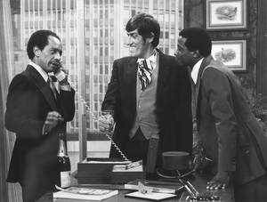 "Photo -   FILE - In this 1977 file photo provided by CBS, from left, Sherman Hemsley, Paul Benedict, and Damon Evans star in an episode of ""The Jeffersons."" Hemsley, the actor who made the irascible, bigoted George Jefferson of ""The Jeffersons"" one of television's most memorable characters and a symbol for urban upward mobility, was found dead Tuesday, July 24, 2012 at his El Paso, Texas home. He was 74. (AP Photo/CBS, File)"