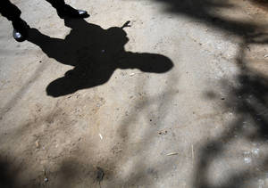 Photo - The shadow of an armed pro-Russian man while guarding the local administration building in the center of Slovyansk, eastern Ukraine, Tuesday, May 6, 2014.   Interior Minister Arsen Avakov gave the death toll on his Facebook page Tuesday, adding that 20 government troops were also injured during fighting in Slovyansk, a city of 125,000, without making clear when the deaths took place.  Gun battles erupted around the city Monday as the interim government tries to quell weeks of unrest in Ukraine's mainly Russian-speaking east.  (AP Photo/Darko Vojinovic)