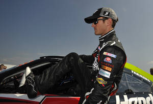 photo -   NASCAR driver Kasey Kahne climbs out of his car after his qualifying attempt at Talladega Superspeedway in Talladega, Ala., Saturday, Oct. 6, 2012. Kahne took to the pole with a speed of 191.455 mph. for Sunday's NASCAR Sprint Cup Series auto race. (AP Photo/Rainier Ehrhardt)