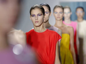 Photo - <p>Models wear creations from Belgian fashion designer Raf Simons for Dior ready to wear Spring-Summer 2013 collection, presented in Paris, Friday, Sept. 28, 2012. (AP Photo/Jacques Brinon)</p>