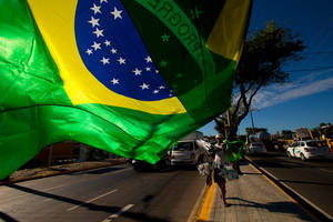 Photo - A street vendor sells representations of Brazil's national flags near the Arena Castelao  in  Fortaleza, Brazil, Wednesday, June 11, 2014.  The Brazil 2014 Word Cup soccer tournament is set to begin Thursday. (AP Photo/Fernando Llano)