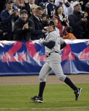 Photo -   New York Yankees' Alex Rodriguez looks back after grounding out in the ninth inning during Game 4 of the American League championship series against the Detroit Tigers, Thursday, Oct. 18, 2012, in Detroit. (AP Photo/Charlie Riedel)