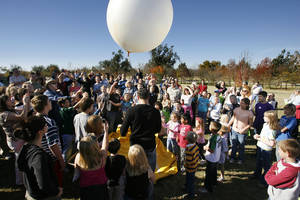 Photo - Weather enthusiasts of all ages gather to watch a weather balloon released at the 2009 National Weather Festival in Norman. This year's festival is scheduled 9 a.m. to 1 p.m. Saturday. PHOTO BY PAUL HELLSTERN, THE OKLAHOMAN
