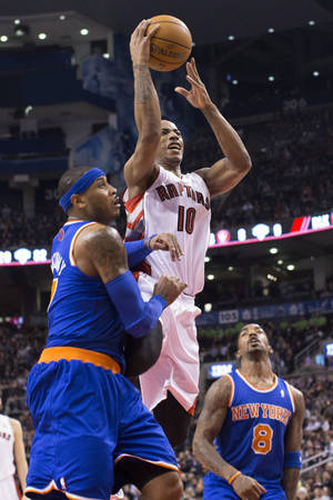 photo - Toronto Raptors' DeMar DeRozan shoots above New York Knicks' Carmelo Anthony, left, and J.R. Smith during the first half of an NBA basketball game in Toronto on Friday, Feb. 22, 2013. (AP Photo/The Canadian Press, Chris Young)