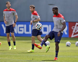Photo - United States' Maurice Edu juggles the ball during a training session in preparation for the World Cup soccer tournament on Friday, May 16, 2014, in Stanford, Calif. (AP Photo/Marcio Jose Sanchez)