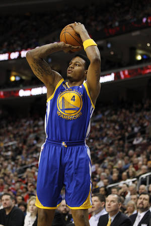 Photo -   In this photo taken March 2, 2012, Golden State Warriors forward Brandon Rush shoots the ball in the first half of an NBA basketball game against the Philadelphia 76ers in Philadelphia. The Warriors have re-signed Rush on Tuesday, July31, 2012, to an $8 million, two-year contract. (AP Photo/Alex Brandon)
