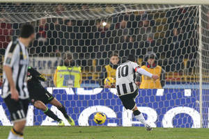 Photo - Udinese forward Antonio Di Natale shoot and scores  during the Italian Serie A soccer match between Bologna and Udinese at Renato Dall' Ara stadium in Bologna, Italy, Saturday, Feb. 1, 2014. (AP Photo/Studio FN)