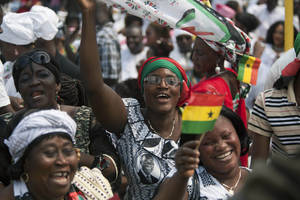 photo - Supporters cheer during the inauguration ceremony for President John Dramani Mahama, at Independence Square in Accra, Ghana, Monday, Jan. 7, 2013. Ghana's President John Dramani Mahama was sworn in Monday for a new four-year term in the West African nation's capital of Accra after winning a closely fought election in December. (AP Photo/Gabriela Barnuevo)