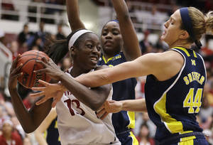 Photo - Stanford's Chiney Ogwumike, left, keeps the ball from Michigan's Rachel Sheffer (44)during the second half of a second-round game in the women's NCAA college basketball tournament on Tuesday, March 26, 2013, in Stanford, Calif. (AP Photo/Ben Margot)