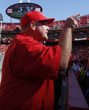 Photo - Kansas City Chiefs coach Andy Reid point to the stands following an NFL football game against the New York Giants at Arrowhead Stadium in Kansas City, Mo., Sunday, Sept. 29, 2013. The Chiefs defeated the Giants 31-7. (AP Photo/Ed Zurga)