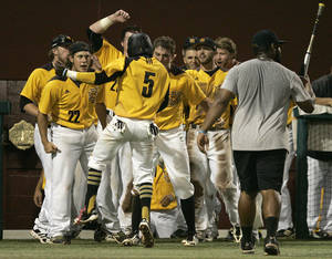 Photo - Kennesaw State's Cornell Nixon, number 5, celebrates after scoring against Georgia Southern in the eleventh inning of an NCAA regional college baseball game on Saturday,  May 31, 2014, in Tallahassee, Fla. Kennesaw State won the game 13-5.  (AP Photo/Steve Cannon)