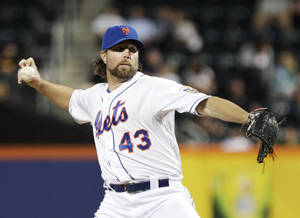 Photo -   New York Mets' R.A. Dickey (43) delivers a pitch during the first inning of a baseball game against the Washington Nationals Tuesday, Sept. 11, 2012, in New York. (AP Photo/Frank Franklin II)