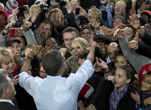 Photo -   President Barack Obama greets people in the crowd after speaking at a campaign event at the Summerfest Grounds at Henry Maier Festival Park, Saturday, Sept. 22, 2012, in Milwaukee. (AP Photo/Carolyn Kaster)