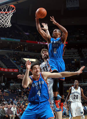 photo - Oklahoma City Thunder guard Russell Westbrook (0) shoots over Thunder forward Nick Collison (4) and Memphis Grizzlies center Marc Gasol (33), of Spain, in the second half of an NBA basketball game Tuesday, Jan. 10, 2012, in Memphis, Tenn. The Thunder defeated the Grizzlies 100-95. (AP Photo/Nikki Boertman). ORG XMIT: TNNB107