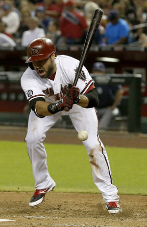Photo - Arizona Diamondbacks' Adam Eaton shouts after being hit on the foot by a pitch from San Diego Padres' Tyson Ross during the fourth inning of a baseball game on Monday, Aug. 26, 2013, in Phoenix. (AP Photo/Ross D. Franklin)