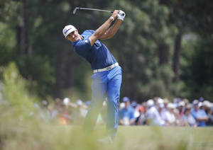 Photo - Dustin Johnson hits from the fairway on the seventh hole during the second round of the U.S. Open golf tournament in Pinehurst, N.C., Friday, June 13, 2014. (AP Photo/Matt York)