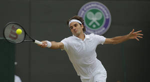 Photo - Roger Federer of Switzerland plays a return to Tommy Robredo of Spain in their men's singles match at the All England Lawn Tennis Championships in Wimbledon, London, Tuesday July 1, 2014. (AP Photo/Pavel Golovkin)