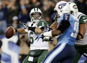 Photo - New York Jets quarterback Mark Sanchez (6) passes against the Tennessee Titans in the second quarter of an NFL football game, Monday, Dec. 17, 2012, in Nashville, Tenn. (AP Photo/Wade Payne)