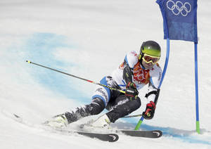 Photo - Georgia's Iason Abramashvili passes a gate in the first run of the men's giant slalom at the Sochi 2014 Winter Olympics, Wednesday, Feb. 19, 2014, in Krasnaya Polyana, Russia. (AP Photo/Charles Krupa)