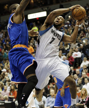 Photo - Minnesota Timberwolves' Derrick Williams, right, attempts a layup as New York Knicks' Amar'e Stoudemire defends in the first period of an NBA basketball game Friday, Feb. 8, 2013 in Minneapolis. (AP Photo/Jim Mone)