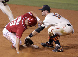 Photo - Oklahoma State's Robbie Rea tags out Oklahoma's Hunter Lockwood during the Bedlam baseball game between the University of Oklahoma and Oklahoma State University at the Chickasaw Bricktown Ballpark in Oklahoma City, Saturday, May 5, 2012. Photo by Sarah Phipps, The Oklahoman